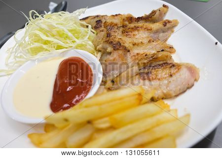 pork steak with french fries and salad for eat