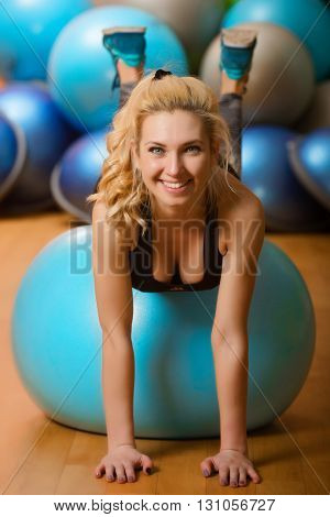 Young beautiful woman works out in the gym