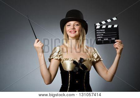 Funny woman in dark studio