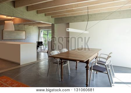 Interior of a villa, modern dining room with cement floor