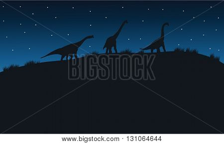 Silhouette of brachiosaurus with star in hills
