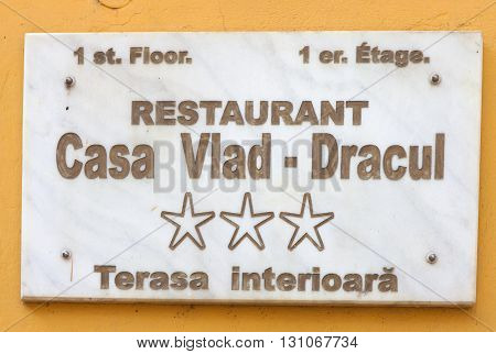 Sighisoara, Romania, May 6, 2016: Marble sign for the birth place and house of Vlad the Impaler, also known as Vlad Dracula or just Dracula, in Sighisoara, Transylvania.