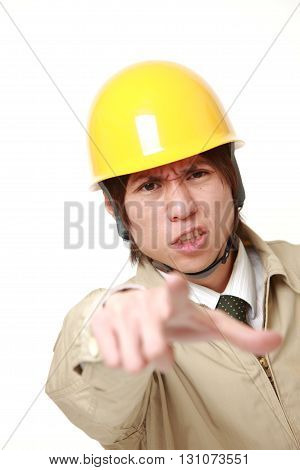 young Japanese construction worker scolding on white background