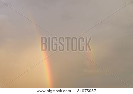 Colorful Rainbow On Rain Cloud Sunset Sky