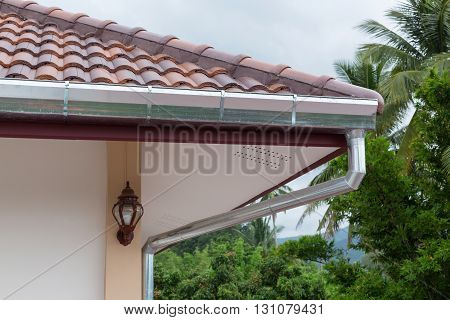 gutter roof residential building house in rainy day poster