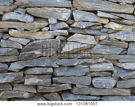 pattern gray color of modern style design decorative uneven cracked real stone wall surface