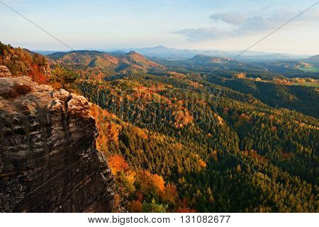 Autumn Sunset In Rocks. View Over Sandstone Rocks To Fall Colorful Valley Of Bohemian Switzerland.