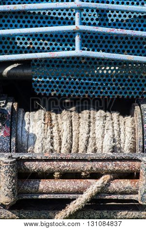 Close up shot of a dirty winch from an off road car.