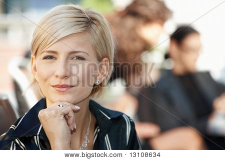 Closeup portrait of attractive businesswoman, thinking.