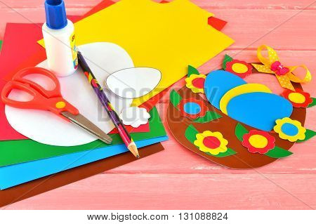 Sheets of colored paper, scissors, glue, pencil, Easter basket and eggs - set for children art