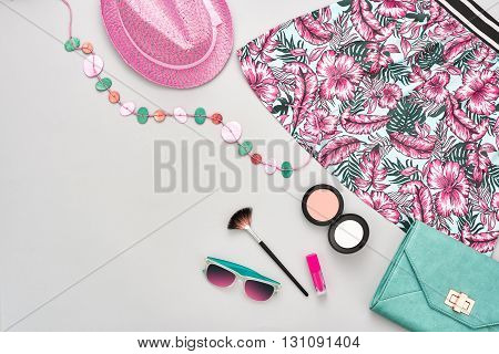 Summer.Summer fashion.Girl clothes accessories set.Woman essentials. Cosmetics, makeup.Stylish handbag clutch, dress, hat, necklace, sunglasses .Unusual overhead summer outfit, summer top view