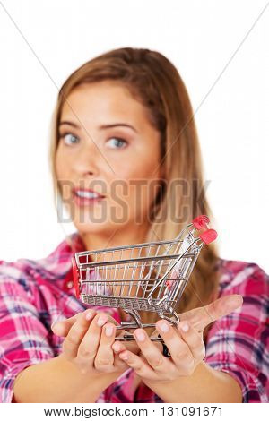 Young woman holding shopping trolley