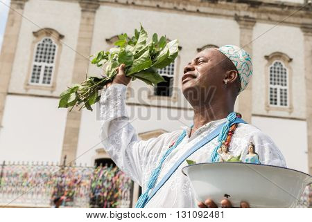 Brazilian man wearing traditional clothes at Bonfim Church in Salvador, Bahia, Brazil