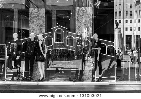 Milan Italy - July 5 2014: Reflections on a shopwindow in San Babila square