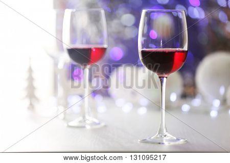 Wineglasses on blurred lights background