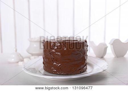 Tasty chocolate cake on light background