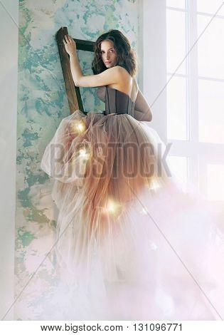 Beautiful woman in designed wedding dress
