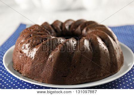 Chocolate cake on blue polka dot napkin