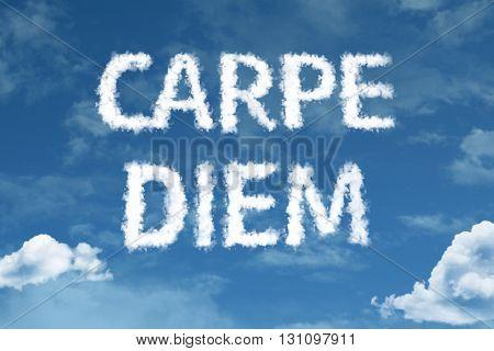 Carpe Diem cloud word with a blue sky