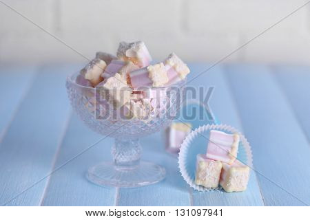 Tasty marshmallows with chocolate in bowl on table, close up