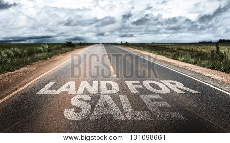 Land For Sale written on rural road
