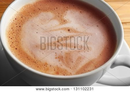 Cup of coffee latte art, closeup