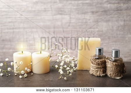 Spa composition with spring flowers on grey background
