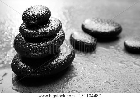 Stack of spa hot stones  on grey background