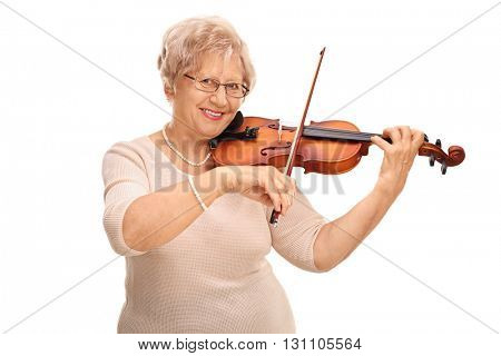 Mature woman playing an acoustic violin and looking at the camera isolated on white background
