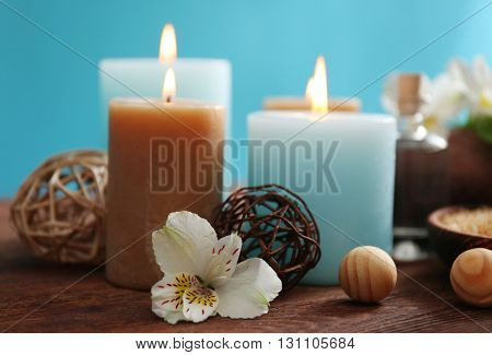 Spa set: soft towel, flowers, massage oil, candles, sea salt, close up