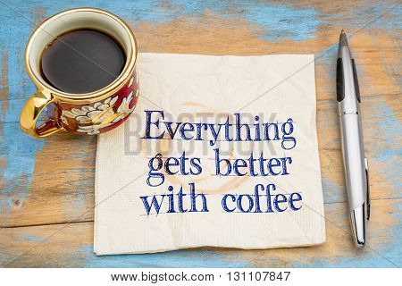 Everything gets better with coffee - handwriting on a napkin with a cup of coffee