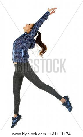 Young sporty woman jumping isolated on white