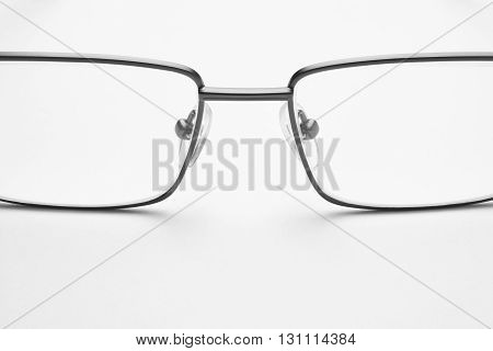 Male eyeglasses macro detail over a white background. Horizontal