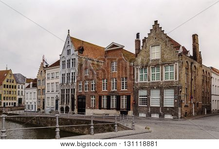 historical houses on Canal embankment in Bruges Belgium