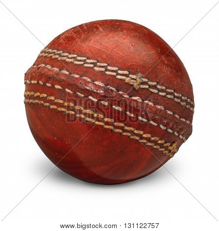 Old worn Cricket Ball on white background