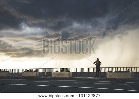 A girl watching spectacular storm in Italy