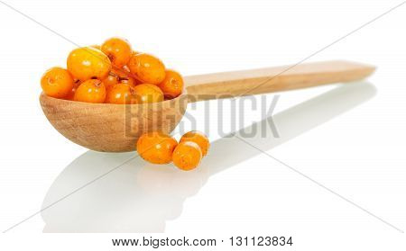 Sea-buckthorn berries in a wooden spoon isolated on white background.