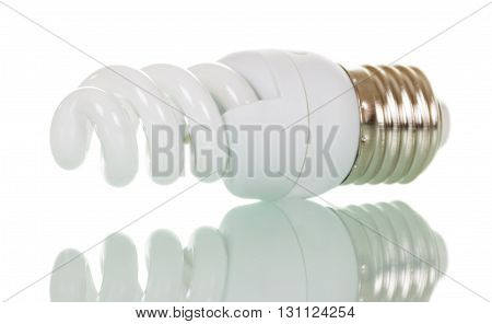 Energy saving fluorescent light bulb isolated on white background.