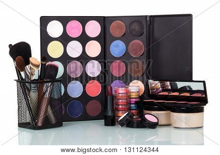 Professional eye shadows palette with makeup brushes. Makeup background