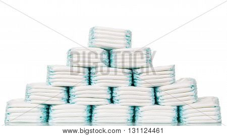 Stacks of diapers stacked in staggered rows isolated on a white background.