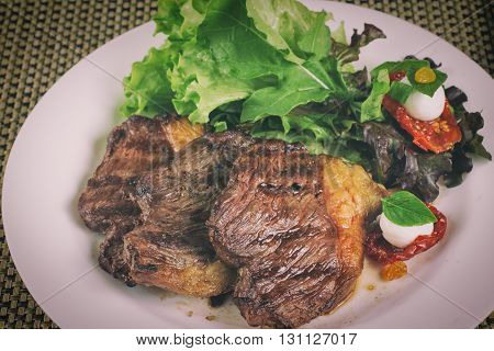 Meal of Traditional Brazilian Picanha with salad