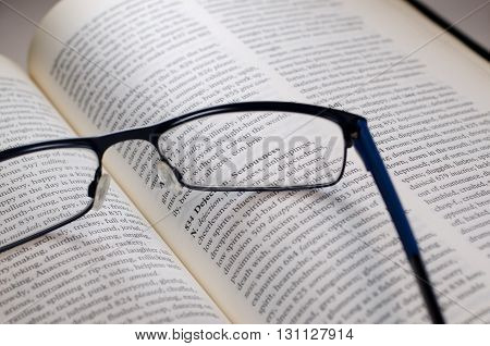 Glasses on book highlighting the word seriousness