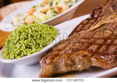 Grilled Pork Fillet with brocolli rice with caesar salad