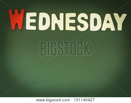 Wooden Wednesday on Green Board. Wood Wednesday word on blackboard with copy space.