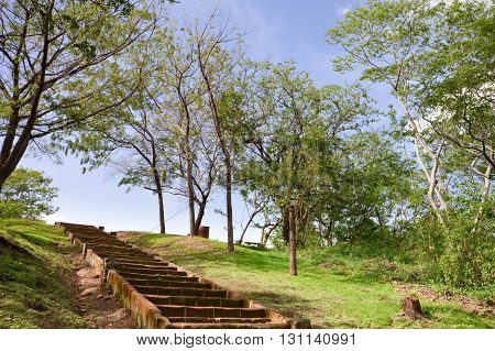 Stairs up the hill in the park within Leon Viejo - ruins of the old city of Leon Nicaragua. The city was abandoned after the quakes and Momtombo eruption in the 17th century. Unesco world heritage site