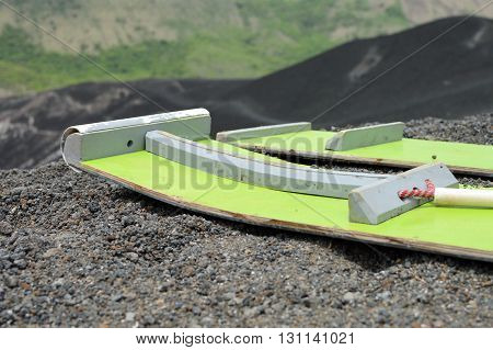 Volcano boarding is a super fun activity for adventurous travelers. Cerro Negro Volcano near Leon Nicaragua. Shallow DOF poster