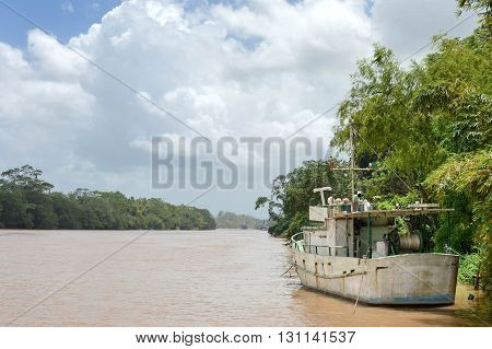 River landscape with a boat and jungle vegetation by the port of Rama on the way to the Caribbean coast River Escondido Nicaragua