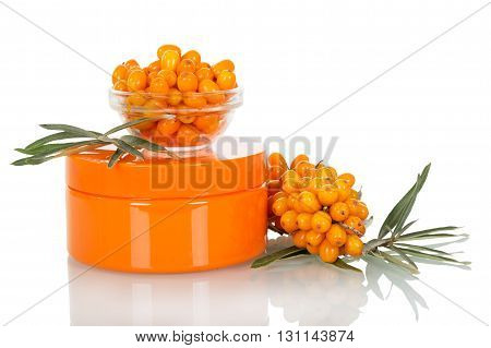 Bunch, a bowl of sea buckthorn berries and cream bank isolated on white background.