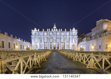 Italy, Rome, Piazza San Pietro - Facade of Saint Peter's Basilica in the night
