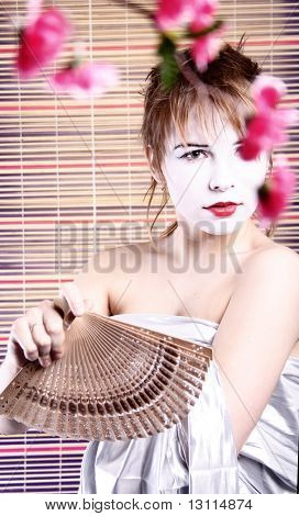 Attractive young  tradition girl with fan.